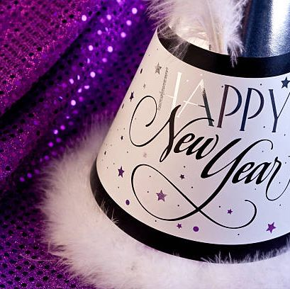 happy new year party hat on purple sequined background see more new years photos below