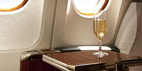 Wine glass, Room, Stemware, Glass, Champagne stemware, Table, Drinkware, Interior design, Furniture, Drink,