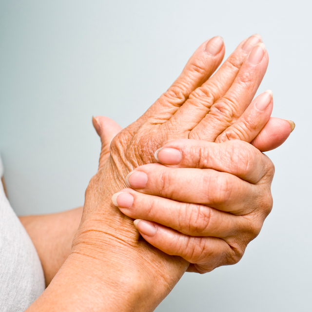 woman holding handwrist out of pain