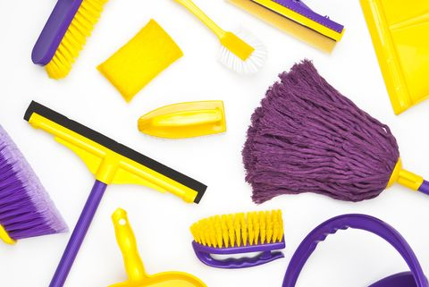 household cleaning supplies shoot from above on white background cleaning concepts