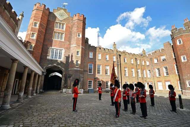 """the st james's palace detachment of the queen's guard turns out in colour court, st james palace, for the arrival of britain's queen elizabeth ii, ahead of the christening of prince george by the archbishop of canterbury on october 23, 2013 the duke and duchess of cambridge broke with tradition by naming only one royal, william's cousin and champion horse rider zara philips, among the godparents, with the others being childhood, university and work friendsthe ceremony welcomes prince george into the church of england, which he is destined to lead as future king and """"defender of the faith"""" afp photopooljohn stillwell        photo credit should read john stillwellafp via getty images"""