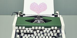 Typewriter printing heart with binary digits