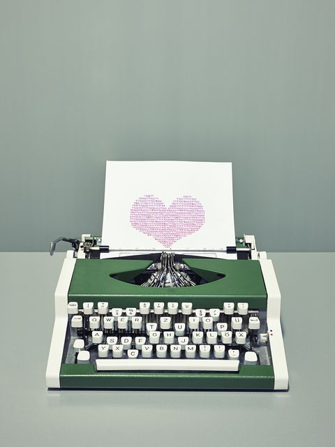retro typewriter printing shape of red heart with binary digits