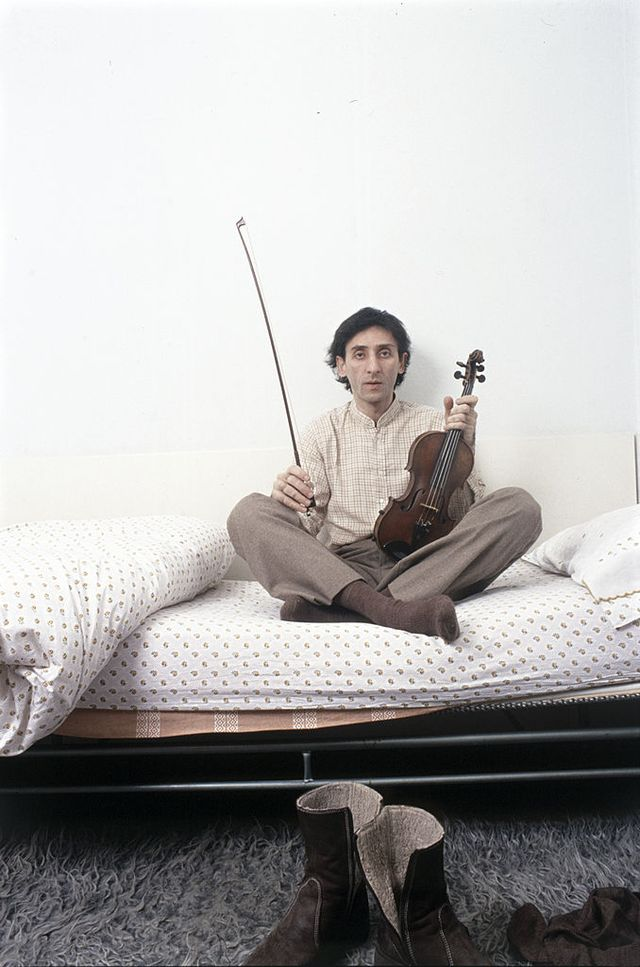 italian singer songwriter and director franco battiato sitting on the bed with a violin in his hand 1981 photo by angelo deligiomondadori via getty images