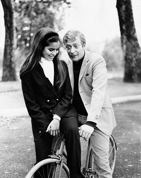 Michael Caine and Bianca De Macias smiling in a park