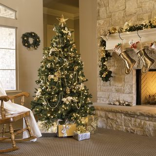 gold christmas morning tree gifts fireplace stockings machristmas tree skirtntel