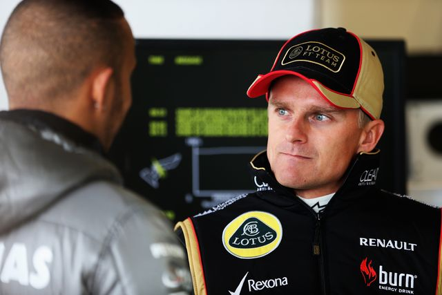 austin, tx   november 15  heikki kovalainen r of finland and lotus talks with lewis hamilton l of great britain and mercedes gp as they prepare to drive during practice for the united states formula one grand prix at circuit of the americas on november 15, 2013 in austin, united states  photo by mark thompsongetty images