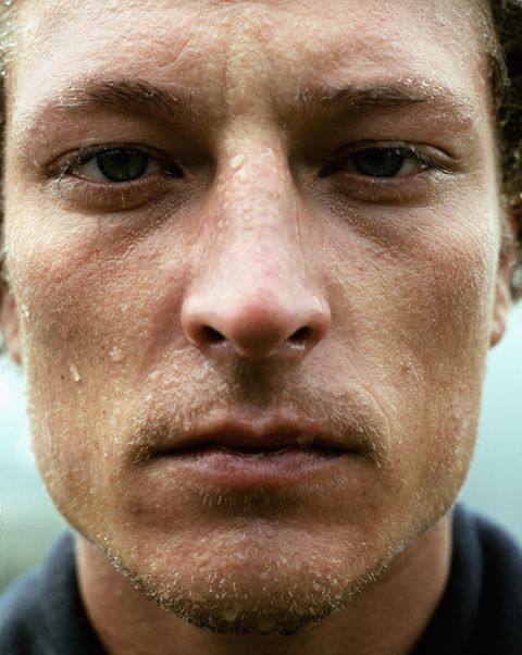 Man perspiring, portrait, close up