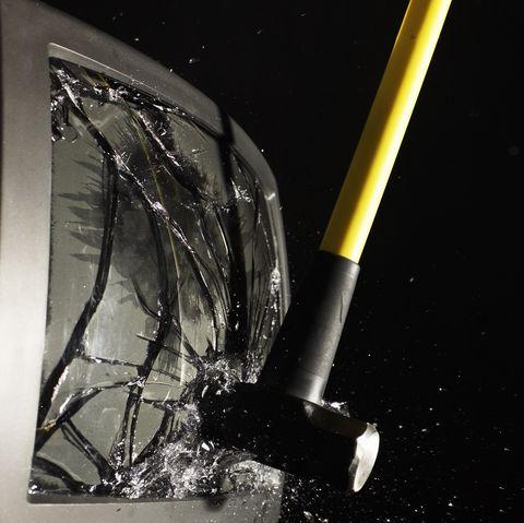 Sledgehammer smashing television screen