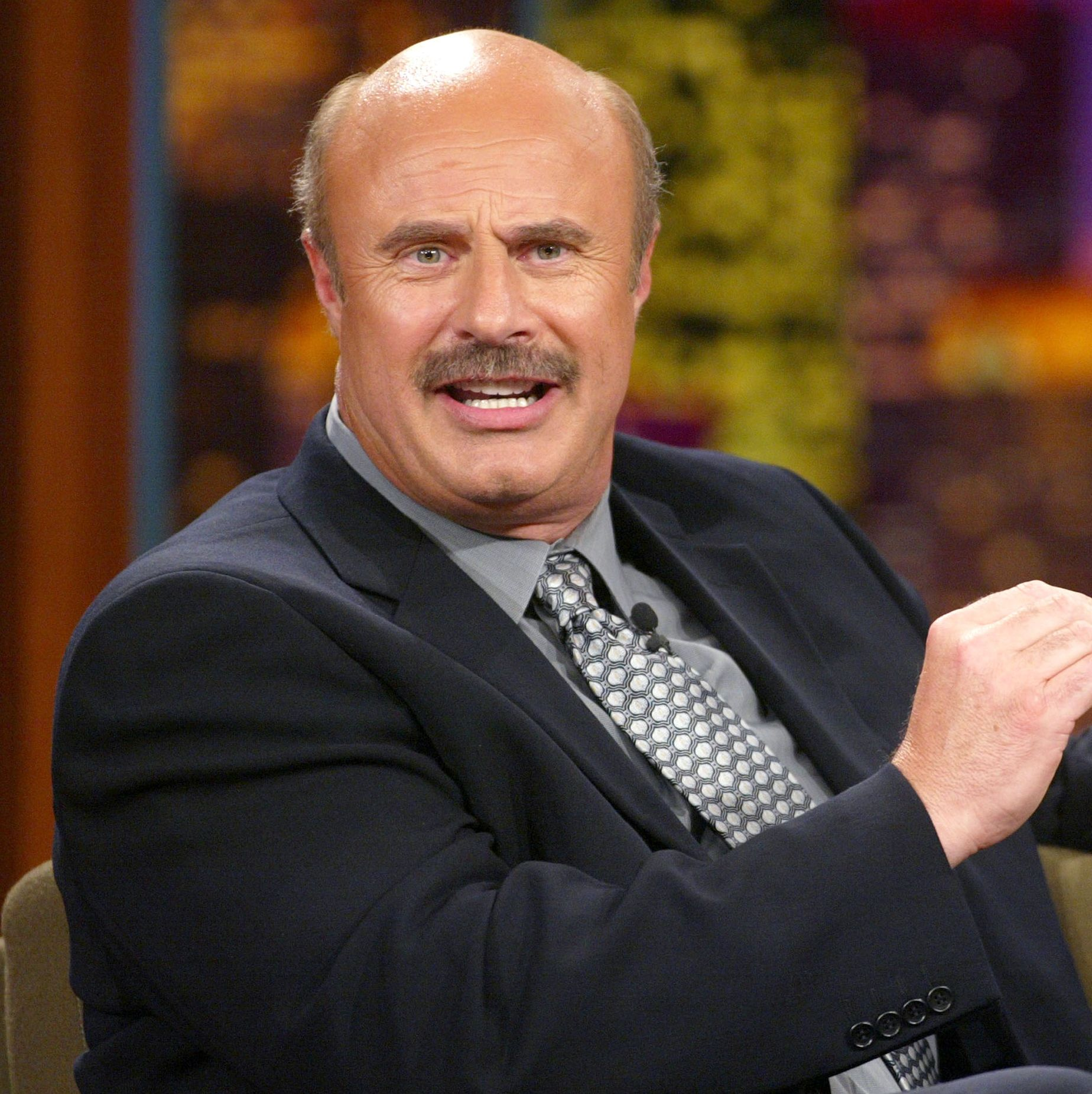 2002: Dr. Phil Bald heads and mustaches are a foolproof combo, which is why Dr. Phil has held onto this look throughout his career.