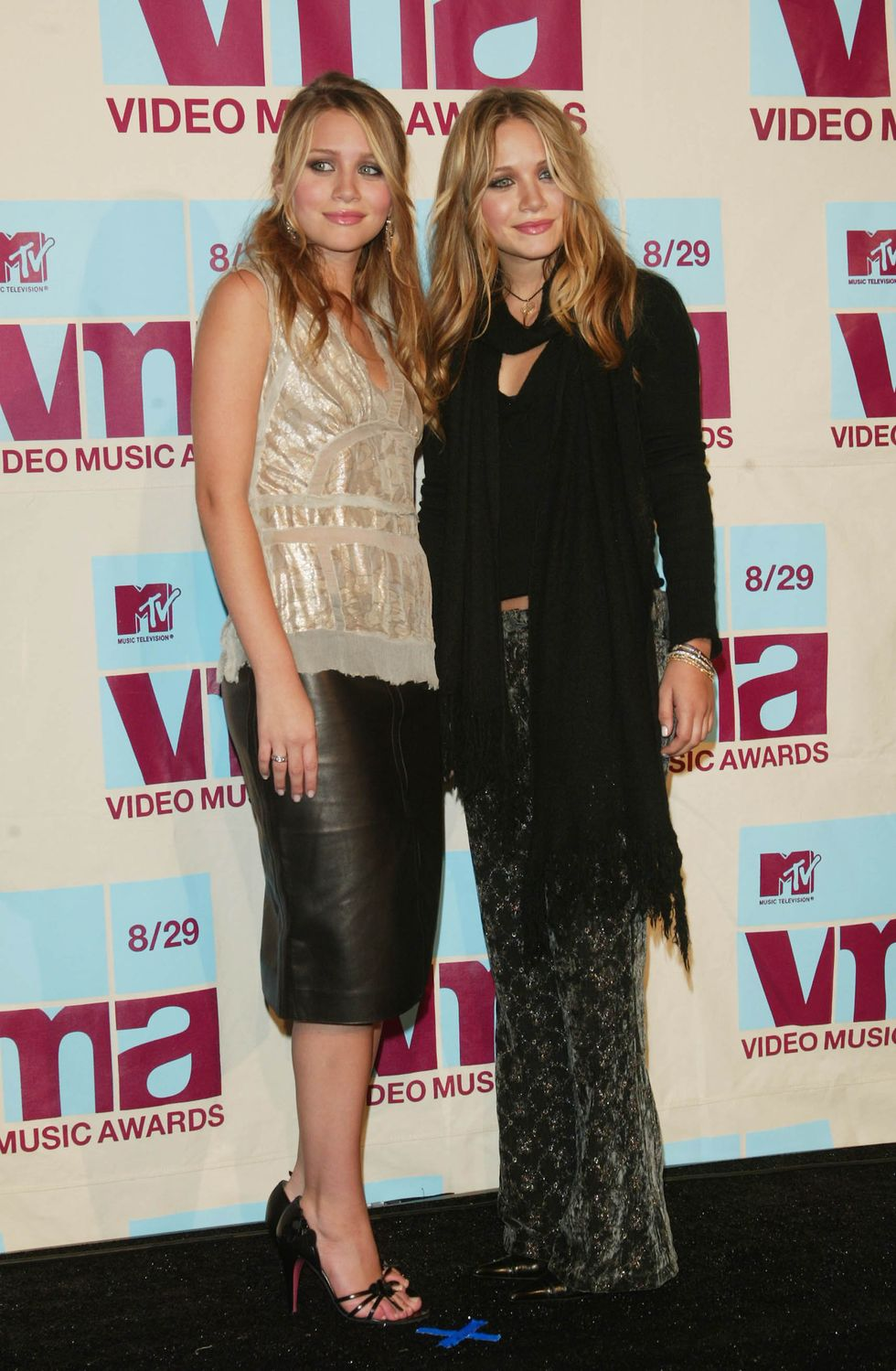 August 29, 2002 For the 2002 Video Music Awards, Ashley wore a metallic camisole and leather skirt, while Mary-Kate opted for a black top and printed velvet pants.