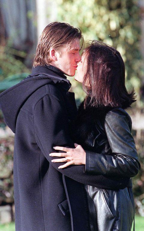 Romance, Interaction, Love, Hug, Jacket, Outerwear, Gesture, Photography, Leather jacket, Fur,