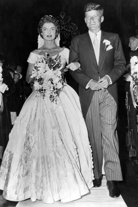 senator john fitzgerald kennedy 1917   1963, democratic senator for massachusetts, escorts his bride jacqueline lee bouvier 1929   1994 down the church aisle shortly after their wedding ceremony at newport, rhode island   photo by keystonegetty images