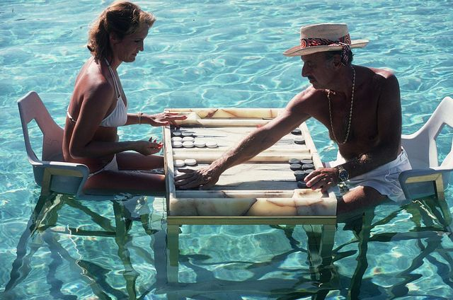 carmen alvarez enjoying a game of backgammon with frank brandy brandstetter in a swimming pool at acapulco   photo by slim aaronsgetty images