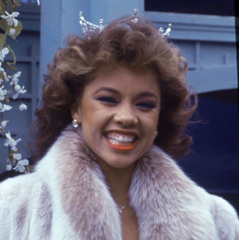 american model and actor vanessa williams, the first african   american miss america, smiles while appearing in the macys thanksgiving day parade, november 24, 1983 she wears her crown and a mink coat photo by tom gatesgetty images