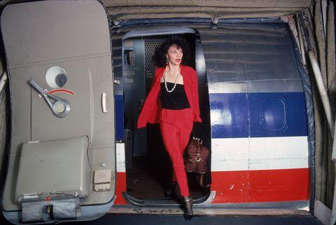 diane von furstenberg disembarking from a plane in red suit, 1976