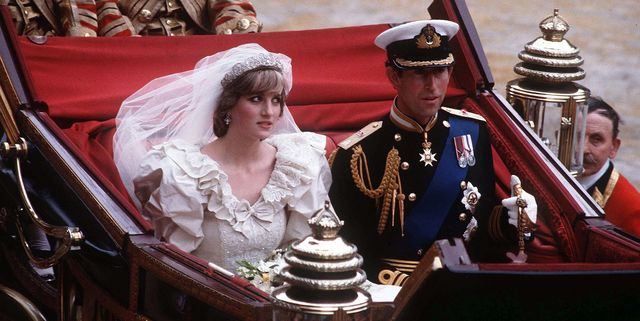 prince charles, prince of wales and diana, princess of wales, wearing a wedding dress designed by david and elizabeth emanuel and the spencer family tiara, ride in an open carriage, from st pauls cathedral to buckingham palace, following their wedding on july 29, 1981 in london, england photo by anwar husseingetty images