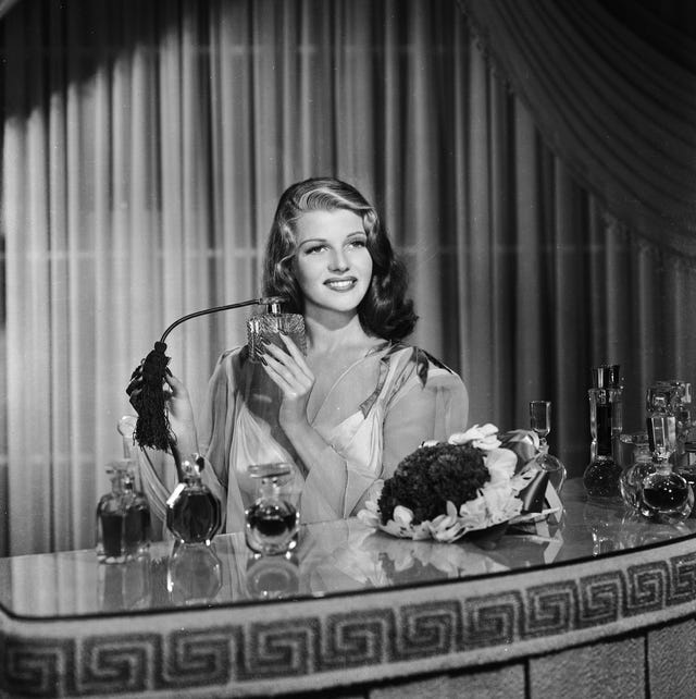 1941  american film actress, dancer and singer rita hayworth 1918   1987 sprays herself with perfume at a dressing table  photo via john kobal foundationgetty images