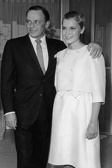 19th july 1966  american singer frank sinatra 1915   1998 stands with his arm around his third wife, actor mia farrow, during their private wedding in las vegas, nevada sinatra wears a suit farrow has close cropped hair and wears a pale colored dress and matching cropped jacket  photo by hulton archivegetty images