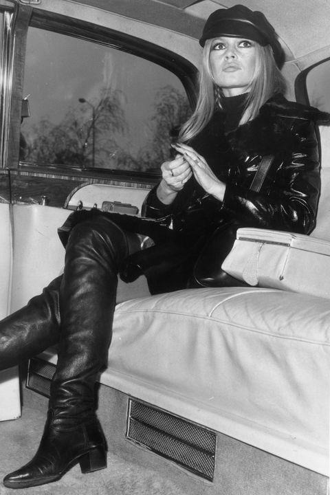 Leather, Leather jacket, Leg, Footwear, Riding boot, Textile, Jacket, Boot, Sitting,
