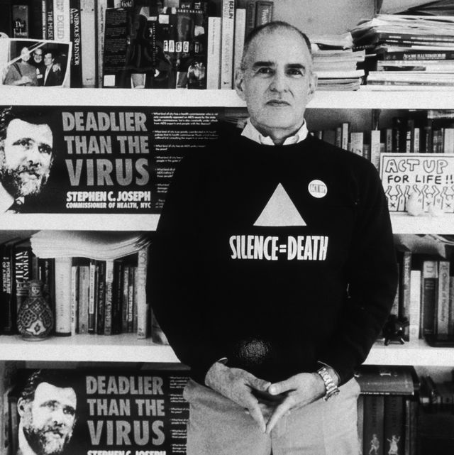 20th december 1989  portrait of american author, aids campaigner and gay rights activist larry kramer, founder of act up and the gay men's health crisis group, posing in front of a book shelf in his home, new york city kramer is wearing a 'silence  death' t shirt  photo by sara krulwichnew york times cogetty images