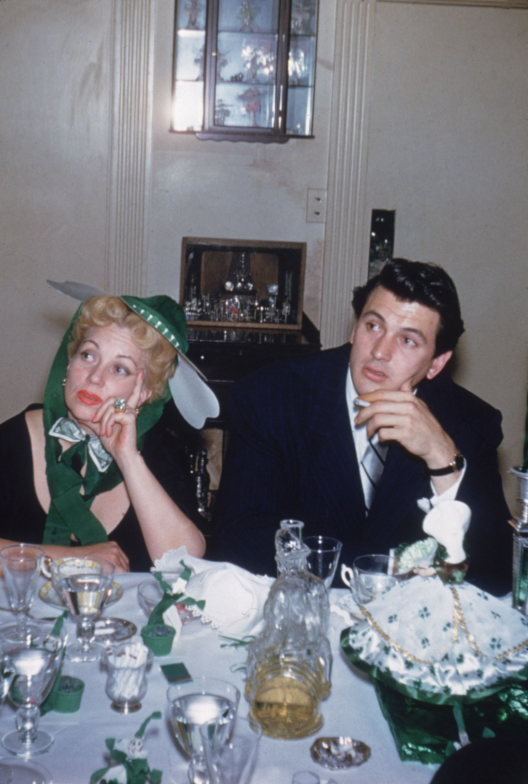 American actors Ann Sothern and Rock Hudson sit next to each other at a St. Patrick's Day party at the home of actor Van Johnson and his wife, Eve, in Beverly Hills, California in 1952.