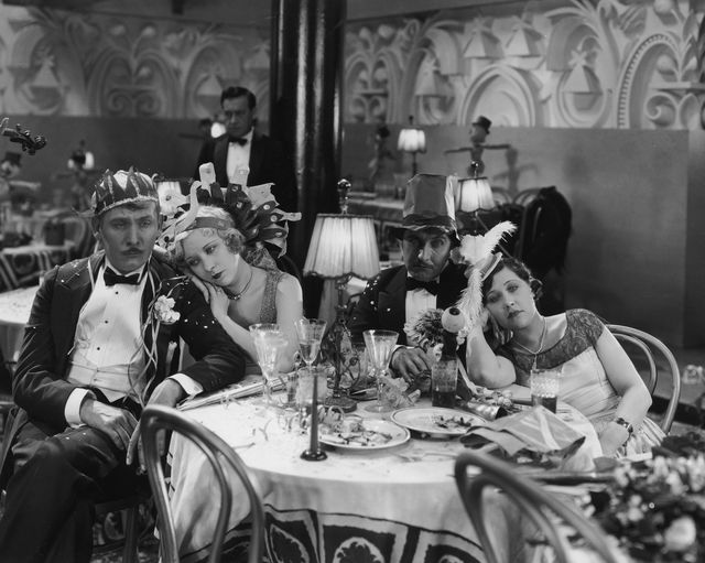 1927  l r american actors lew cody 1884 1934, gwen lee 1904 1961, roy darcy 1894 1969 and gertrude short 1902 1968 look sad in their party hats while sitting in an empty restaurant in a still from director robert z leonards film, adam and evil  photo by hulton archivegetty images