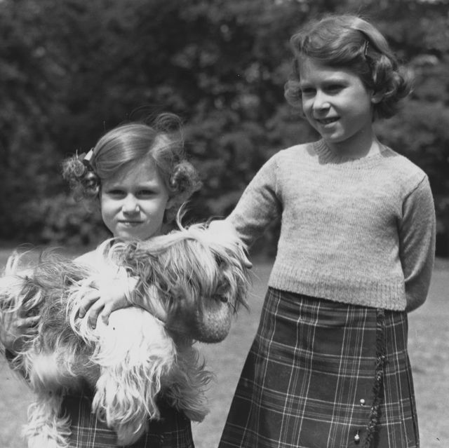june 1936  queen elizabeth ii as princess elizabeth and her younger sister princess margaret 1930   2002 in the grounds of the royal lodge, windsor  princess margaret is holding one of their pet dogs, a cairngorm terrier called chu chu  photo by lisa sheridanstudio lisagetty images