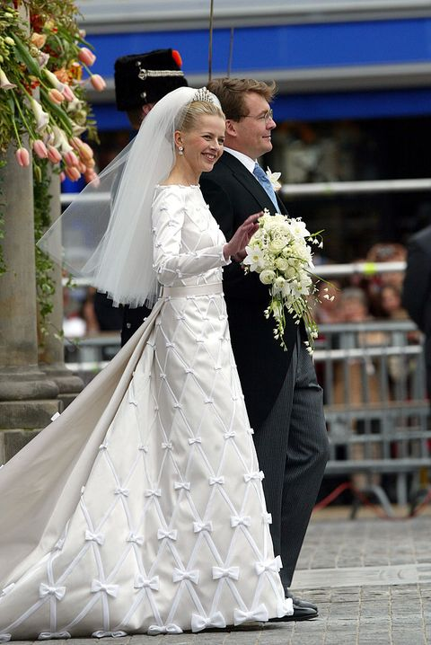 delft, netherlands   april 24  dutch queen beatrixs second son, prince johan friso and mabel wisse smit leave the city hall after the civil ceremony on april 24, 2004 in delft, the netherlands mabels silk wedding gown was made by dutch designers victor  rolf whos team of four worked 600 hour to complete in total 248 hand made bows were sewn from small to large on the dress and train photo by michel porrogetty images