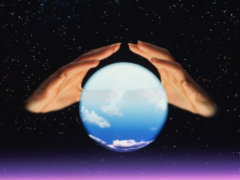 Fortune tellers hands and crystal ball