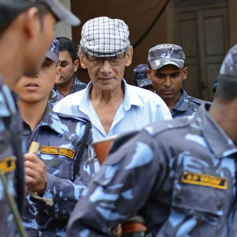 french serial killer charles sobhraj c is escorted by nepalese police at a district court for a hearing on a case related to the murder of canadian backpacker laurent ormond carriere, in bhaktapur on june 12, 2014 sobhraj, a french citizen who is serving a life sentence in nepal for the murder of an american backbacker in 1975, has been linked with a string of killings across asia in the 1970s, earning the nickname bikini killer afp photoprakash mathema        photo credit should read prakash mathemaafp via getty images