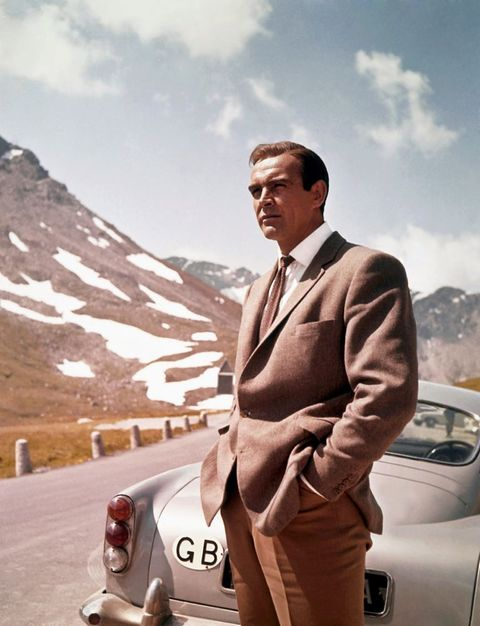 1964  actor sean connery poses as james bond next to his aston martin db5 in a scene from the united artists film goldfinger in 1964 photo by donaldson collectionmichael ochs archivesgetty images