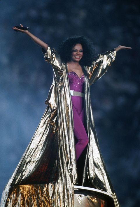 Purple, Outerwear, Performance, Photography, Event, Black hair, Performance art, Photo shoot, Performing arts, Formal wear,