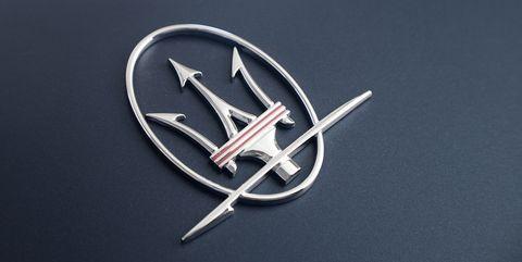 Font, Logo, Vehicle, Symbol, Car, Fashion accessory, Emblem, Silver, Metal, Trademark,