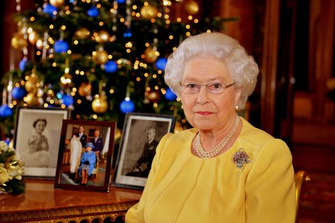 london, united kingdom   december 12 queen elizabeth ii records her christmas message to the commonwealth, in the blue drawing room at buckingham palace on december 12, 2013 in london england broadcast on december 25, 2013, the queen wears a diamond, ruby and sapphire brooch given to her by her parents to celebrate the birth of prince charles in 1948 by her side are photographs of her parents, king george vi and queen elizabeth   the queen mother, and also a picture from this years christening of prince george of cambridge photo by john stillwell   wpa poolgetty images