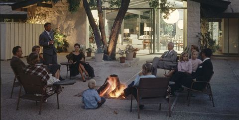 a group of people sit around a fire pit on the patio of a a ranch house home designed by architect cliff may, los angeles, california, april 7, 1956 cliff may is credited with inventing the california ranch housestyle photo by gordon parksthe life picture collection via getty images