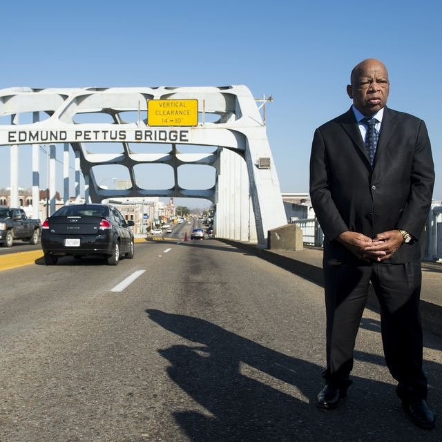 """united states   february 14 rep john lewis, d ga, stands on the edmund pettus bridge in selma, ala, in between television interviews on feb 14, 2015 rep lewis was beaten by police on the bridge on """"bloody sunday"""" 50 years ago on march 7, 1965, during an attempted march for voting rights from selma to montgomery photo by bill clarkcq roll call"""