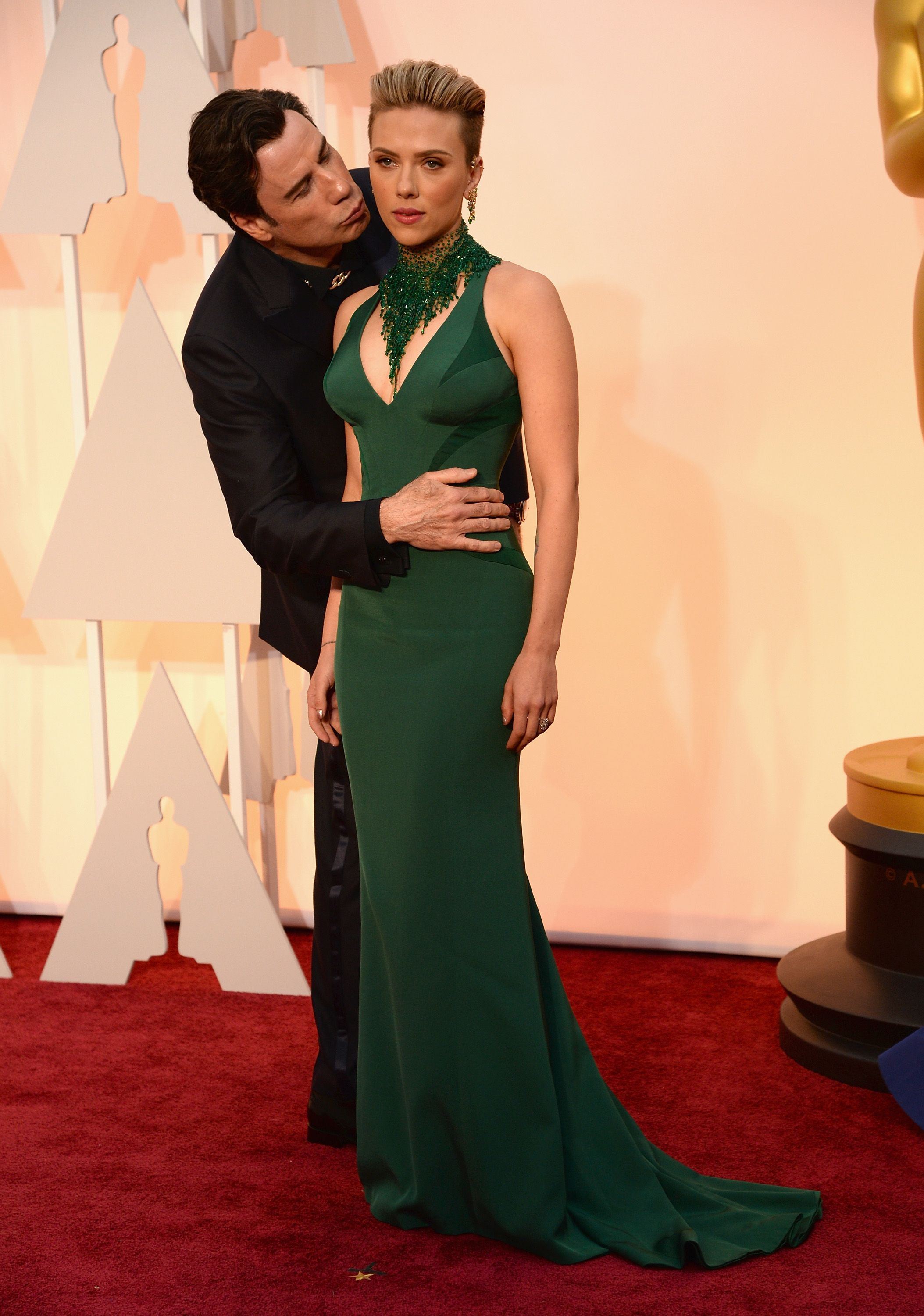 2014: When John Travolta was weird with Scarlett Johansson. Despite Johansson's captured reaction in this photo, the actress said Travolta's Oscar kisses were more than acceptable .