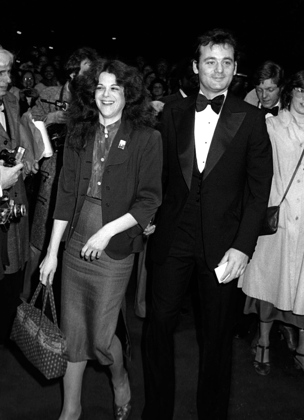 Gilda Radner and Bill Murray attend the premiere of Manhattan on April 18, 1979 at the Ziegfeld Theater in New York City.