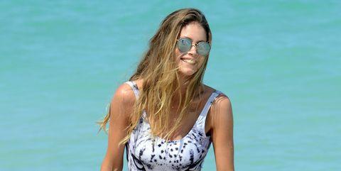 Clothing, Swimwear, Bikini, Photo shoot, Summer, Vacation, Human leg, Leg, Model, Fashion model,