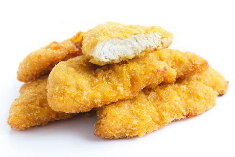 golden fried chicken strips on white