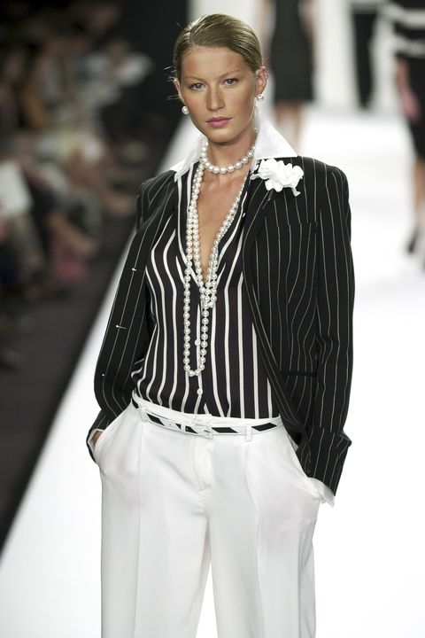 Fashion model, Fashion, Fashion show, White, Runway, Clothing, Outerwear, Human, Fashion design, Blazer,
