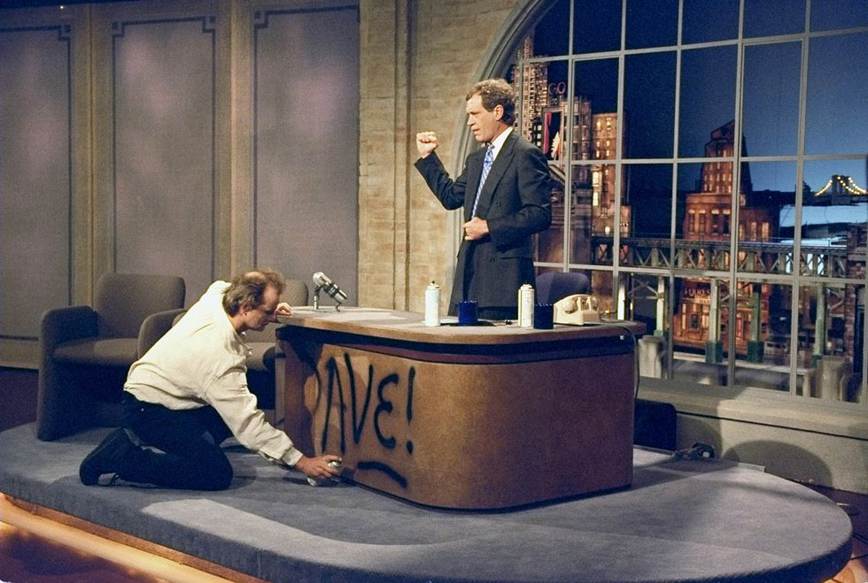 Bill Murray spray paints Dave's desk on the first taping of the Late Show with David Letterman, August 30, 1993.