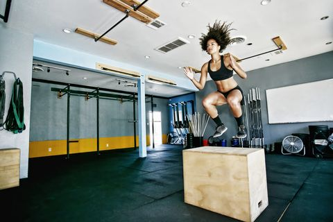 box jump woman at gym