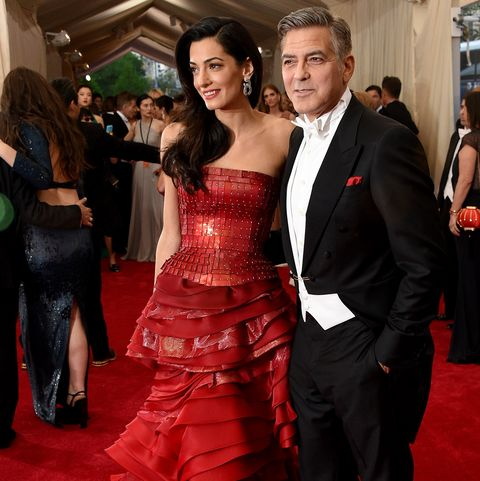 Carpet, Red carpet, Dress, Gown, Flooring, Clothing, Strapless dress, Red, Premiere, Formal wear,