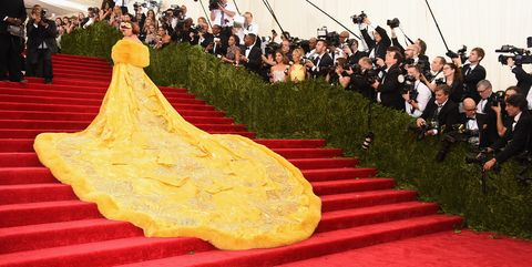 Red carpet, Carpet, Flooring, Dress, Yellow, Event, Tradition, Leisure, Gown,