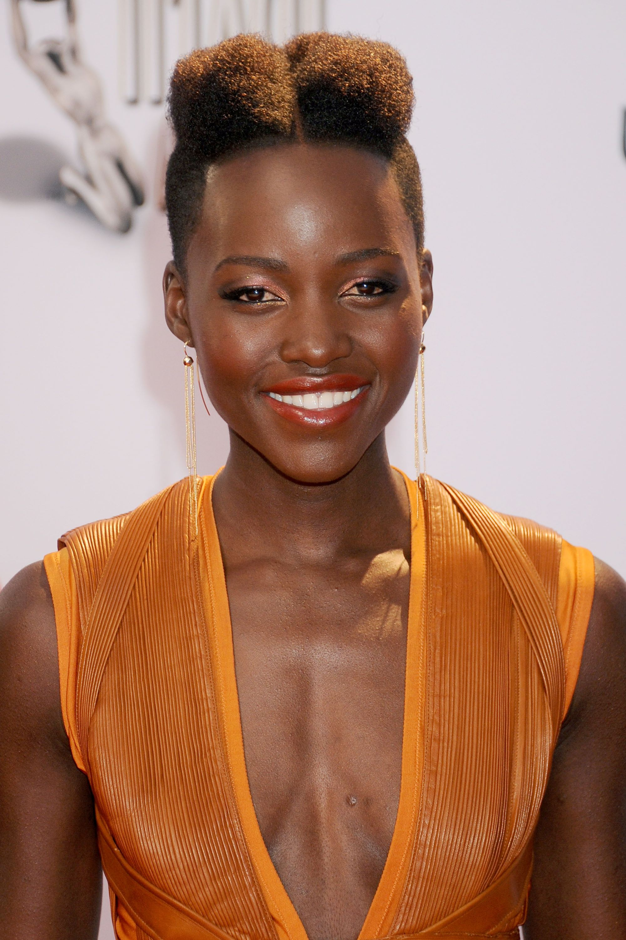 "Lupita Nyong'o It's impossible to pick just one of the ""best"" short styles Lupita Nyong'o has worn so well throughout the years. She honestly deserves her own gallery, because this woman makes magic with her natural hair."