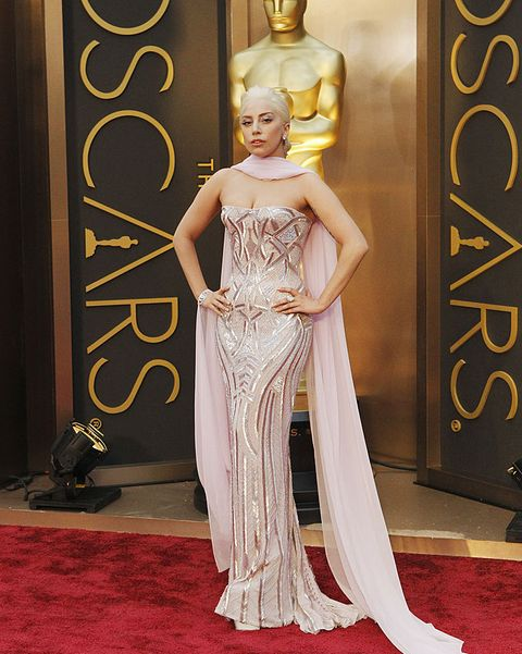 Red carpet, Carpet, Gown, Dress, Clothing, Fashion model, Flooring, Haute couture, Fashion, Formal wear,
