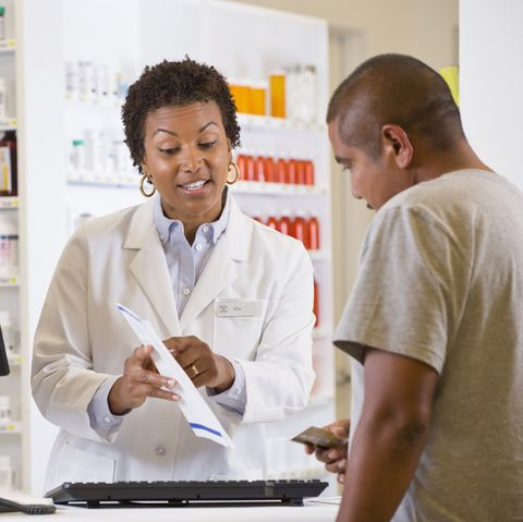 Customer talking to pharmacist