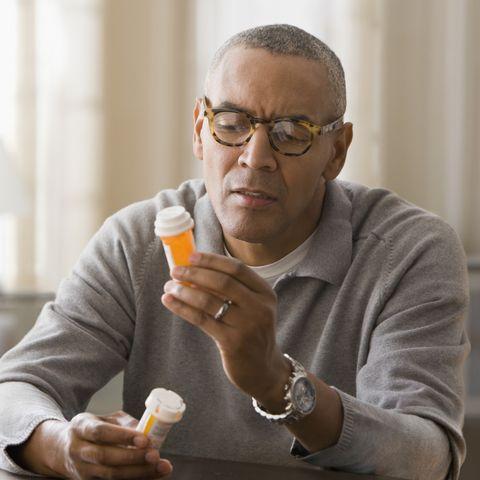 reading info on medication bottle